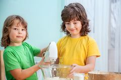 Happy family funny kids are preparing the dough, bake cookies in. The kitchen Royalty Free Stock Images
