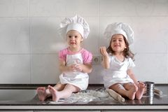 Happy family funny kids are preparing the dough, bake cookies in the kitchen.  Stock Images