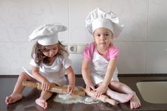 Happy family funny kids are preparing the dough, bake cookies in the kitchen Stock Photo