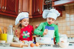 Happy family funny kids are preparing the dough, bake cookies in the kitchen Royalty Free Stock Photo