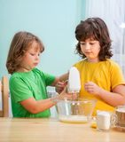Happy family funny kids are preparing the dough, royalty free stock photography