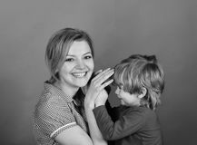 Happy family game. Woman and little boy with smiling faces on green background. Parenthood and happy moments concept. Mother and son playing games Stock Photos