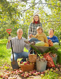 Happy  family  in garden Royalty Free Stock Photos