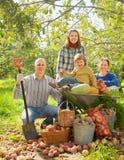 Happy family in garden royalty free stock photos