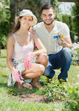 Happy family in garden with horticultural sundry. For planting flowers Royalty Free Stock Photos