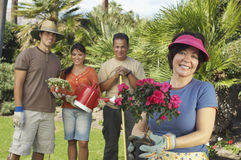 Happy Family Gardening In Lawn Stock Photos