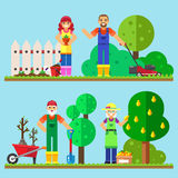Happy family gardening working in the garden. Stock Photos