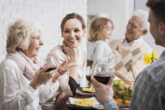 Happy family gathering. Happy multi-generational family gathering during holidays at the table Royalty Free Stock Photo