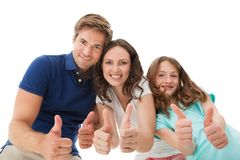 Happy family gesturing thumbs up Stock Photos