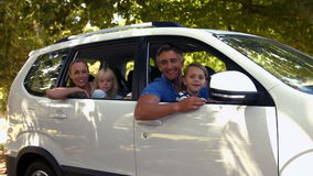 Happy family getting ready for road trip and looking at camera
