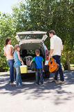 Happy family getting ready for road trip Stock Images