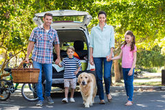 Happy family getting ready for road trip Royalty Free Stock Photos