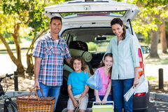 Happy family getting ready for road trip Royalty Free Stock Photo