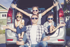 Happy family getting ready for road trip on a sunny day. Concept of friendly family stock photography