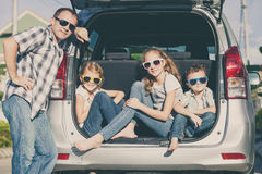 Happy family getting ready for road trip on a sunny day Royalty Free Stock Image