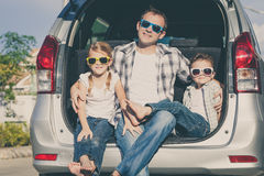 Happy family getting ready for road trip on a sunny day Stock Photo