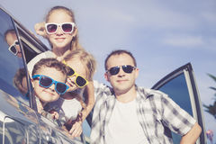Happy family getting ready for road trip on a sunny day Stock Photos