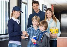 Happy Family Getting Tickets Checked By Worker At Stock Photography
