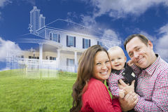 Happy Family with Ghosted House Drawing Behind. Happy Family with Ghosted House Drawing and Rolling Green Hills Behind Royalty Free Stock Photos