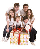Happy family with gift box. Happy family with christmas red gift box. Isolated stock photo