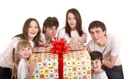 Happy family with gift box. Happy family with big gift box. Isolated Royalty Free Stock Images