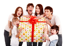 Happy family with gift box. Happy family with big gift box. Isolated royalty free stock photos