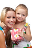 Happy family with gift box. Happy family with gift box on a white background Stock Images