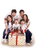 Happy family with gift box. Isolated royalty free stock photos