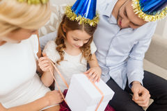 Happy family with gift box Stock Photography