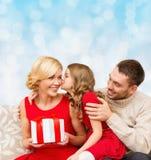 Happy family with gift box Royalty Free Stock Photo