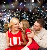 Happy family with gift box Stock Photos