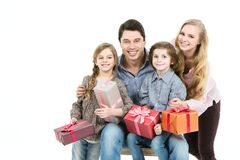 Happy family with gift box isolated. Stock Photography