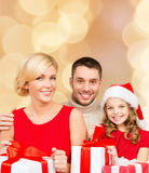 Happy family with gift boxes Stock Photos