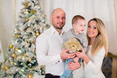 Happy family with gift. Christmas. Royalty Free Stock Photo