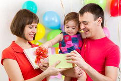 Happy family with gift for kid girl Stock Image