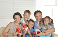 Happy family with gifts Stock Photos