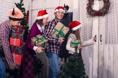 Happy family with gifts in their hands royalty free stock image