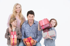 Happy family with gifts. Stock Image