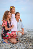 Happy family with girl on beach, Looking afar Royalty Free Stock Photo