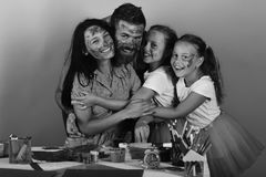 Happy family. Girls, man and woman with happy faces by art desk. Happy family. Girls, men and women with happy faces by art desk with stationery. Artistic family royalty free stock photo
