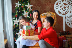 Happy family give gifts each other stock photo