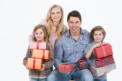 Happy family gives gifts Royalty Free Stock Photography