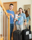 Happy family going on holiday Stock Images