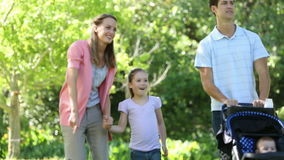 Happy family going on a walk in the park Royalty Free Stock Image