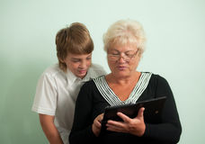 Happy family: Grandmother and grandson. Royalty Free Stock Photography