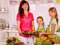 Happy family with grandmother at kitchen Stock Images