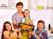Happy family with grandmother at kitchen Royalty Free Stock Image