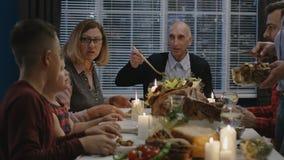 Cheerful family enjoying Thanksgiving day dinner