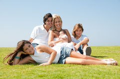 Happy family on grass Royalty Free Stock Photos
