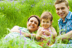 Happy family in grass Stock Photos
